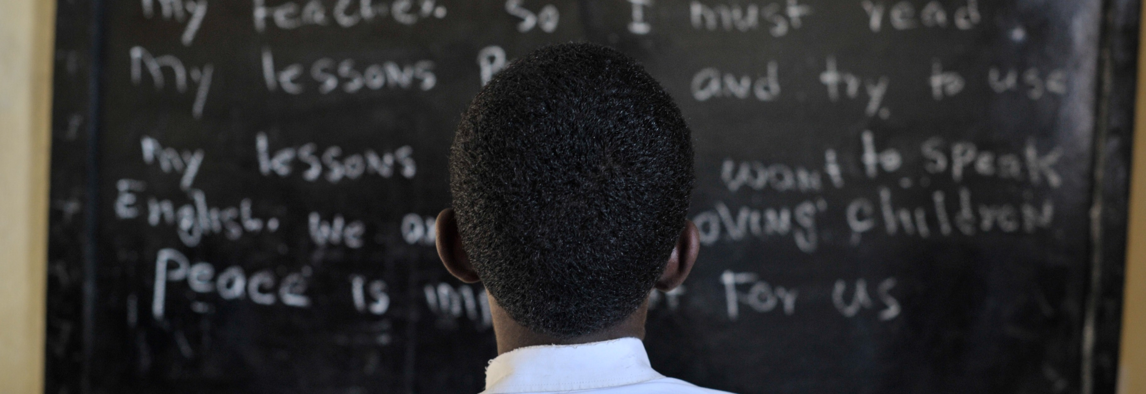 A Somali boy reads from the board during English class at as school run by the Abdi Hawa Center in the Afgoye corridor on September 25. Dr. Hawa, an internationally recognized humanitarian, established the Hawa Abdi Center in 1983, and has catered for tens of thousands over the years displaced by civil war in Somalia. The center now contains an IDP camp, a school, and a hospital. AU UN IST PHOTO / Tobin Jones