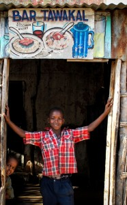SOMALIA, Buur-Hakba: In a photograph taken and released by the African Union-United Nations Information Support team 28 February 2012, a young Somali boy stands in the doorway to a roadside restaurant in the central Somali town of Buur-Hakba following it's capture the day before from the Al-Qaeda-affiliated extremist group Al Shabaab by the Somali National Army (SNA), supported by forces of the African Union Mission in Somalia (AMISOM). The strategically important town linking the capital Mogadishu and the hinterlands of central Somalia was liberated without a shot being fired, marking a significant loss for the group. Under the Shabaab's repressive and violent rule, social and leisure past-times such as football were banned in every form including watching and playing. The town, located 64kms east of Baidoa, Somalia's second city, was a stronghold of the Shabaab where they extorted high levies of illegal taxation on the local civilian populations and used it as a base from where they planned and launched attacks against government forces and installations, AMISOM and the Somali population. Buur-Hakba is the latest in a string of notable territorial losses for the extremist group to SNA and AMISOM forces over the last 18 months, which has seen their area of influence and control over towns and areas across Somalia steadily and rapidly decrease. AU-UN IST PHOTO / STUART PRICE.