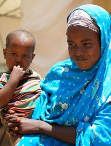 SSOMALIA, Mogadishu: In a photograph taken 04 March 2013 and released by the African Union-United Nations Information Support Team 06 March, two Somali girls hold their twin brothers outside a tented-hospital ward at a free Outpatient's Department (OPD) medical clinic at the headquarters of the Burundi Contingent serving with the African Union Mission in Somalia (AMISOM) at the former National University in the Somali capital Mogadishu. Since Burundi first deployed it's troops to Somalia in 2007 as part of the AU mission, their free medical facilities have been a lifeline for thousands of civilians that were caught-up and injured during fighting with the Al-Qaeda-affiliated extremist group Al Shabaab in and around Mogadishu, and in 2012 alone, they treated over 50,000 patients at the clinic. The OPD clinic is held twice a week, treating hundreds of civilians and would be more regular but for the limited medical supplies; the Burundians share much of their own resources, as well as distributing those donated by external NGO groups and other organisations. The United Nations Security Council are due to renew AMISOM's mandate for another one year as the country gradually stabilises and begins rebuilding after more two decades of conflict and civil war. Sustained operations over the last 18 months by AMSIOM forces in support of the Somali National Army (SNA) have pushed Al-Shabaab out of Mogadishu and all but a few of their former urban strongholds and territory across Somalia. AU-UN IST PHOTO / STUART PRICE.